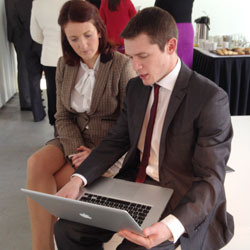 Peter Hughes demos the new CIM website to Claire Bradshaw Marketing Manager of Titanic Belfast.